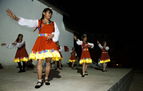 Dancing group in a village